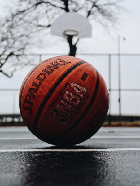 Basketball and hoop by TJ Dragotta, Unsplash