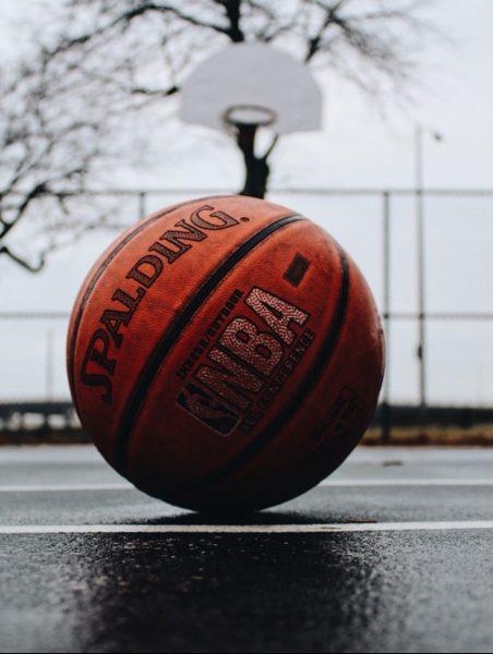 Basketball and hoop by TJ Dragotta, Unsplash